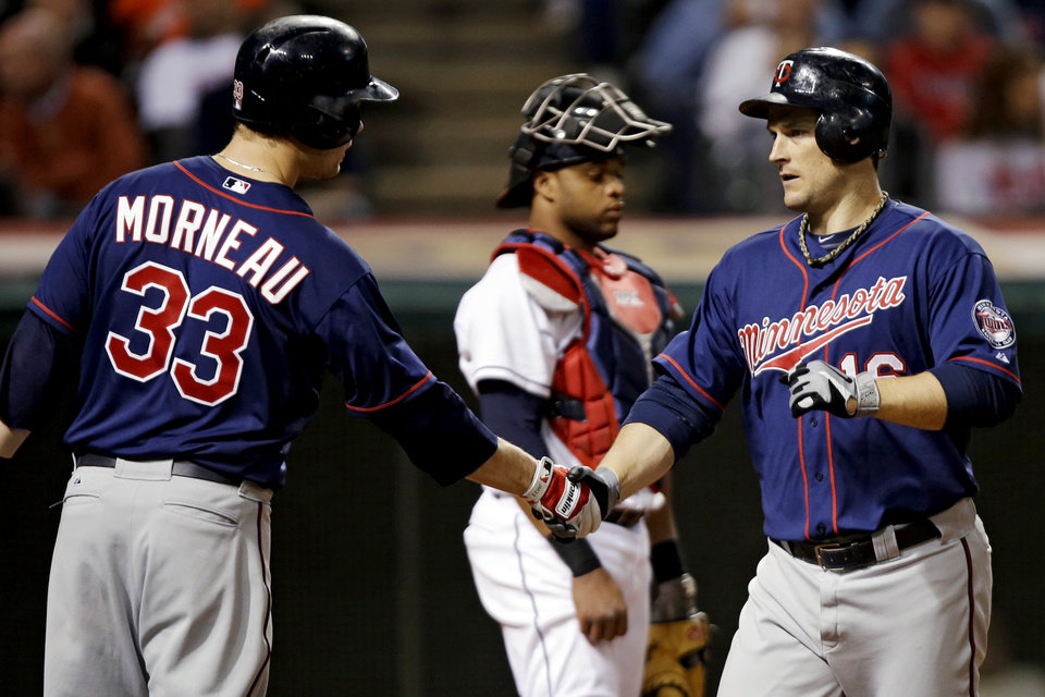 Photo -   Minnesota Twins' Justin Morneau (33) greets Josh Willingham after Willingham's two-run home run off Cleveland Indians starting pitcher Zach McAllister in the fifth inning of a baseball game, Wednesday, Sept. 19, 2012, in Cleveland. (AP Photo/Mark Duncan)