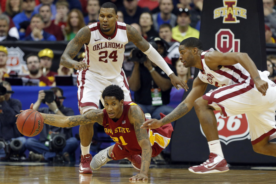Photo - Iowa State's Will Clyburn (21) dives for a loose ball as Oklahoma's Romero Osby (24) and Oklahoma's Steven Pledger (2) defend during the Phillips 66 Big 12 Men's basketball championship tournament game between the University of Oklahoma and Iowa State at the Sprint Center in Kansas City, Thursday, March 14, 2013. Photo by Sarah Phipps, The Oklahoman