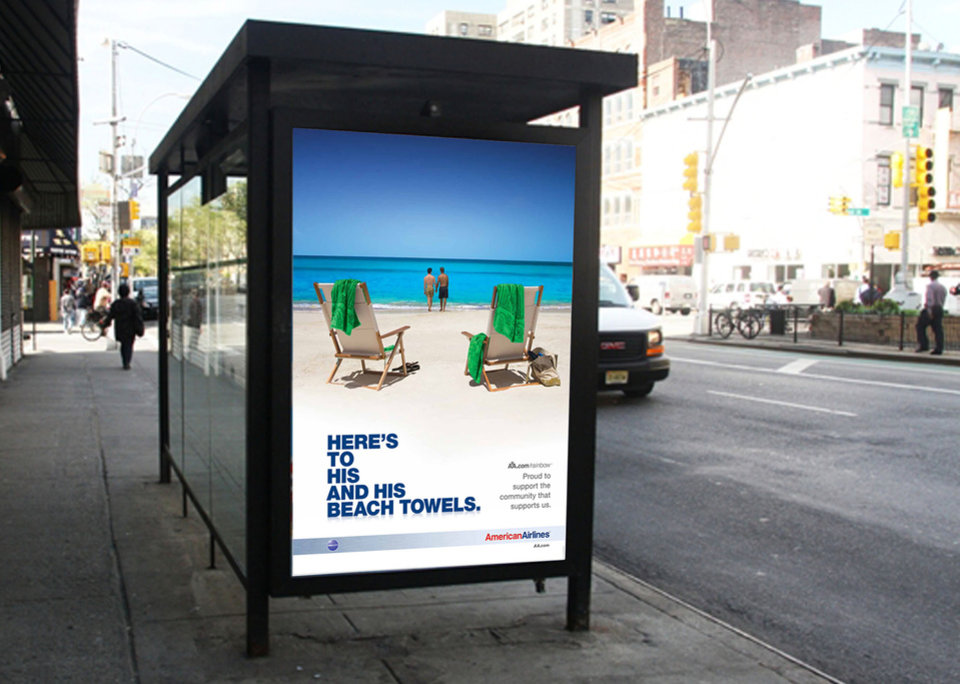 Photo - This 2010 image released by American Airlines shows a travel ad for American Airlines showing two men on a beach displayed at a bus stop shelter in New York.  The slogan reads,