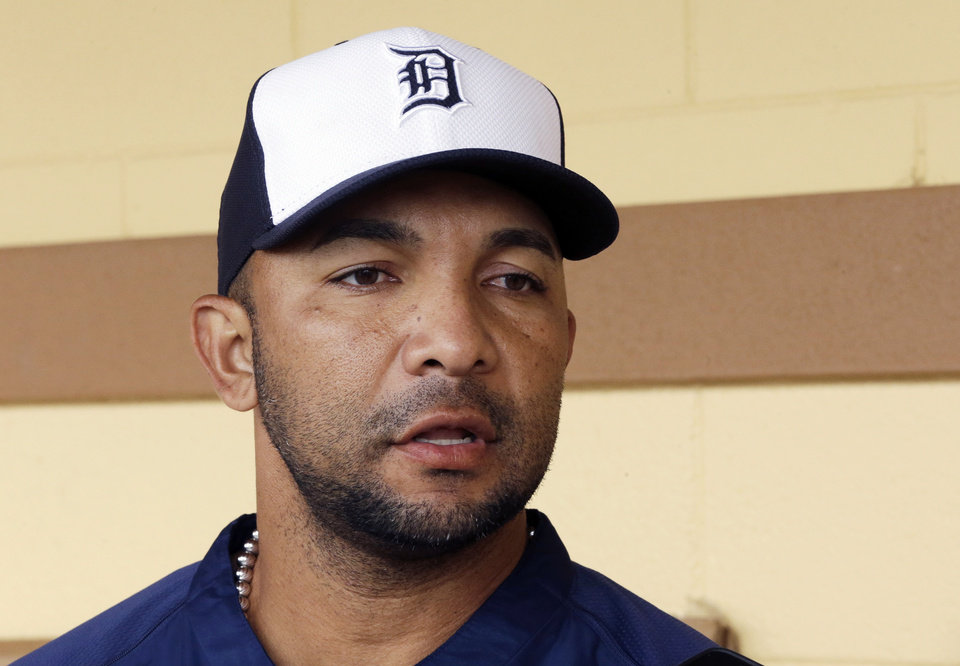 Photo - Detroit Tigers shortstop Alex Gonzalez meets with the media before a spring exhibition baseball game against the Atlanta Braves in Lakeland, Fla., Tuesday, March 25, 2014. Gonzalez, a former Baltimore Orioles player was acquired in exchange for Tigers utility man Steve Lombardozzi. (AP Photo/Carlos Osorio)
