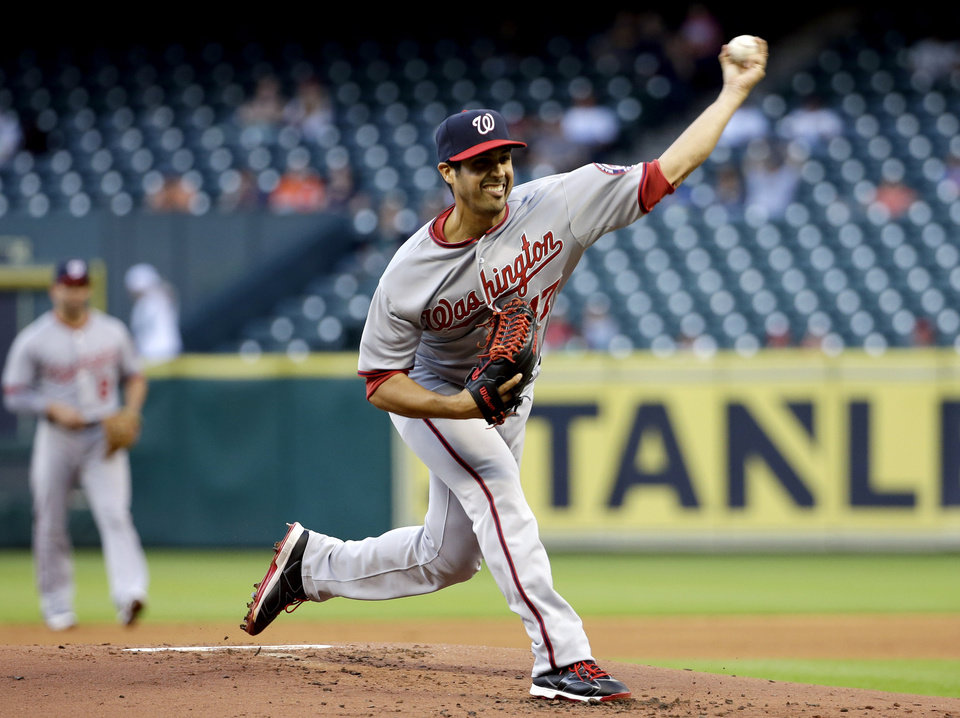 Photo - Washington Nationals starting pitcher Gio Gonzalez throws to a Houston Astros batter during the first inning of a baseball game Tuesday, April 29, 2014, in Houston. (AP Photo/David J. Phillip)
