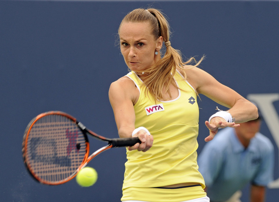 Photo - Magdalena Rybarikova, of Slovakia, hits a forehand during her 6-2, 6-4 semifinal victory over Camila Giorgi, of Italy, at the New Haven Open tennis tournament in New Haven, Conn., on Friday, Aug. 22, 2014. (AP Photo/Fred Beckham)