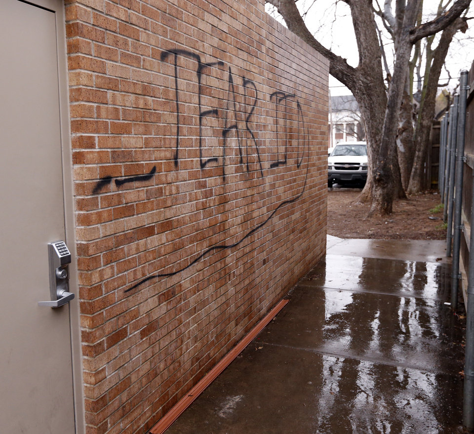 Photo - Vandalism of the University of Oklahoma Sigma Alpha Epsilon fraternity house is shown on March 9, 2015 in Norman, Okla.  The house was vandalized after a video showing racist comments was made public. Photo by Steve Sisney, The Oklahoman