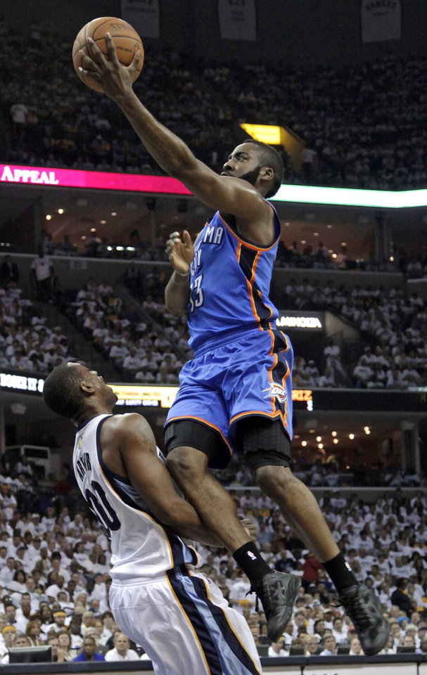 Photo - Oklahoma City Thunder guard James Harden, right, drives against Memphis Grizzlies forward Darrell Arthur (00) during the first half of Game 3 of a second-round NBA basketball series on Saturday, May 7, 2011, in Memphis, Tenn. (AP Photo/Lance Murphey)