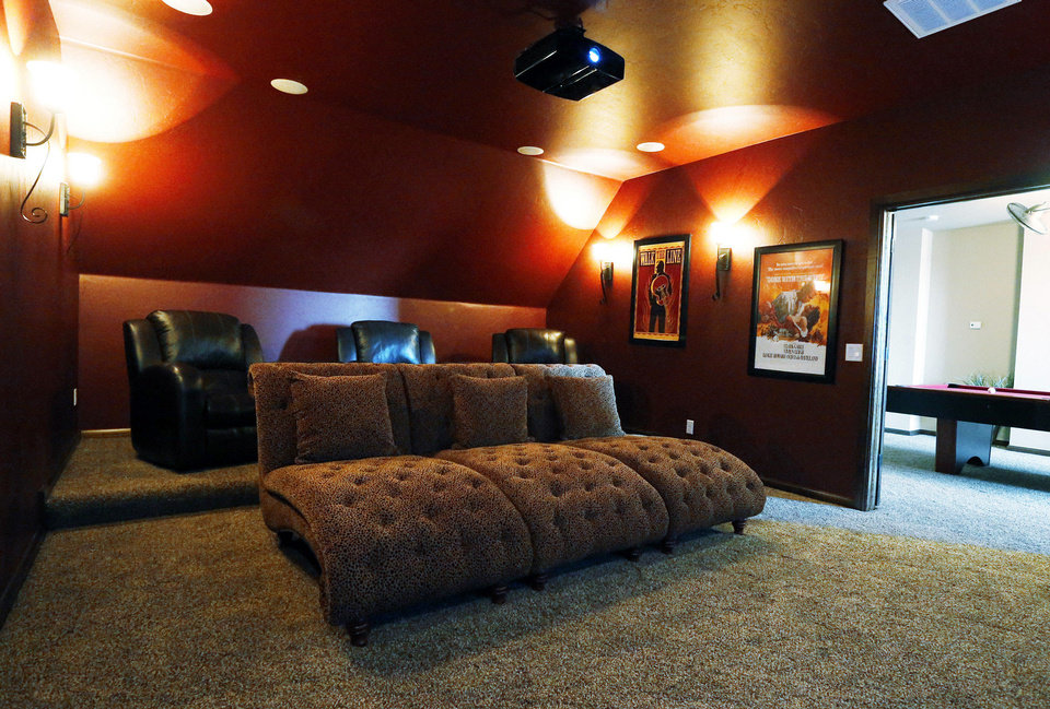 A decked-out theater-media room is among the features of the model home.