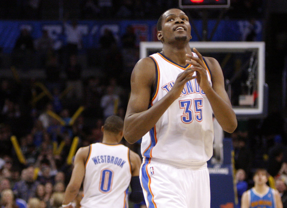 Photo - Oklahoma City's Kevin Durant (35) celebrates during the NBA basketball game between Oklahoma City Thunder and New Orleans Hornet, Wednesday, Feb. 2, 2011 at the Oklahoma City Arena. Photo by Sarah Phipps, The Oklahoman