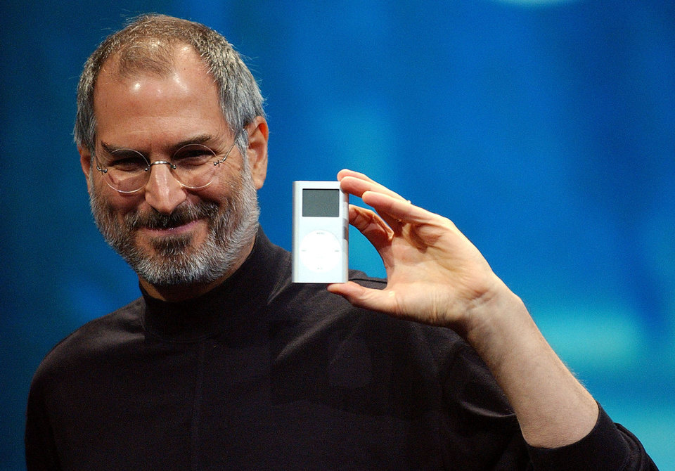 Photo - The late Steve Jobs' distinctive style included the beard, along with blue jeans, black shirts and a seemingly neverending supply of marvelous Apple gadgets.  MARCIO JOSE SANCHEZ - AP