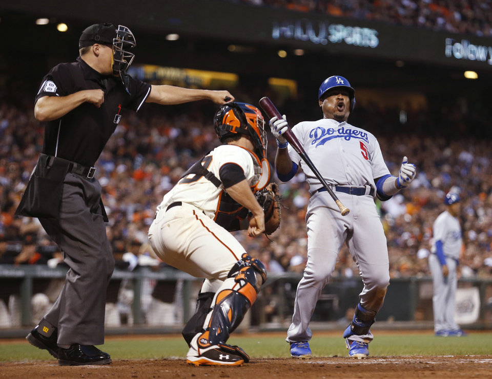 Photo - Los Angeles Dodgers' Juan Uribe reacts to home plate umpire Adam Hamari's strikeout call during the seventh inning of a baseball game against the San Francisco Giants, Saturday, July 26, 2014, in San Francisco. (AP Photo/Beck Diefenbach)