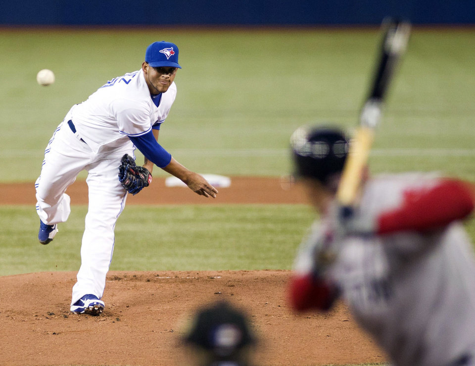 Photo -   Toronto Blue Jays starter Henderson Alvarez throws out the first pitch of the Jays' home-opener baseball game against the Boston Red Sox in Toronto on Monday, April 9, 2012. (AP Photo/The Canadian Press, Frank Gunn)