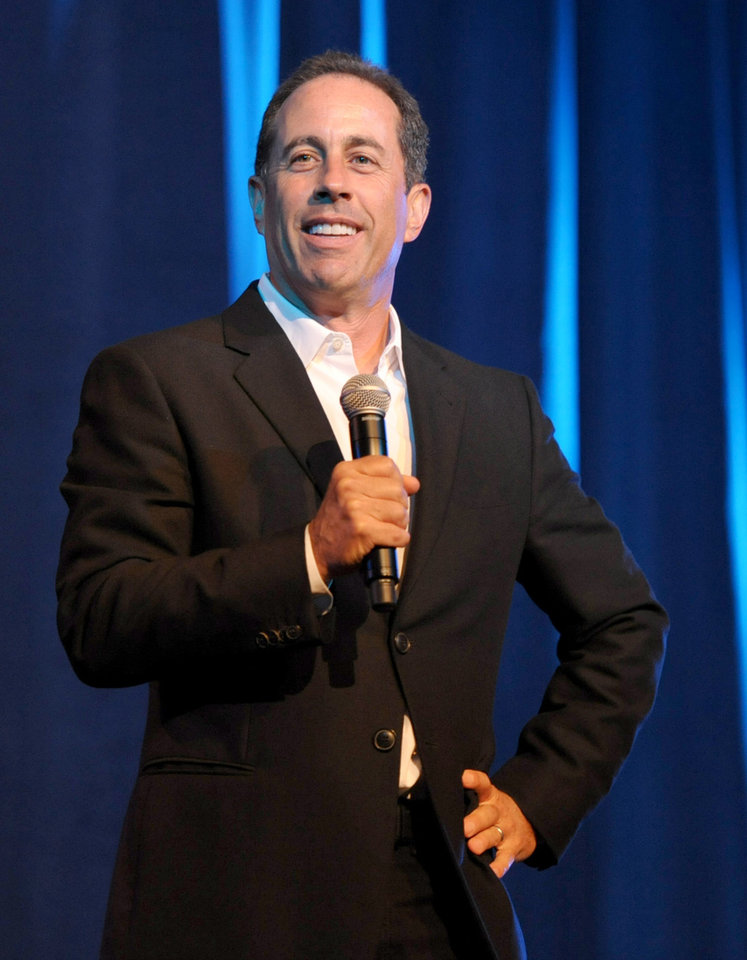 """FILE - This June 30, 2012 file photo shows comedian Jerry Seinfeld performing at the David Lynch Foundation: A Night of Comedy honoring George Shapiro in Beverly Hills, Calif. Seinfeld will receive a Webby for Outstanding Comedic Performance for his hit Web series """"Comedians in Cars Getting Coffee."""" The 10-episode series, which chronicles the conversations between Seinfeld and his comedian friends, including Ricky Gervais, Alec Baldwin and Larry David, demonstrated the continued merging of Hollywood-style entertainment with the Internet. (Photo by John Shearer/Invision/AP, File)"""