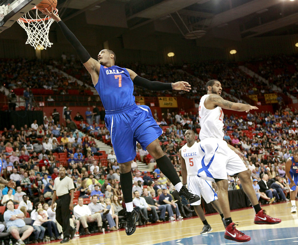 Photo - Carmelo Anthony puts in a shot for the Blue Team during the US Fleet Tracking Basketball Invitational at the Cox Convention Center in Oklahoma City Sunday, Oct. 23, 2011. The White Team defeated the Blue Team 176-171. Photo by John Clanton, The Oklahoman