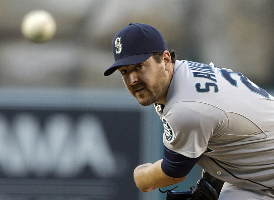 Photo - Seattle Mariners starter Joe Saunders pitches to the Los Angeles Angels in the first inning of a baseball game in Anaheim, Calif., Saturday, Sept. 21, 2013. (AP Photo/Reed Saxon)