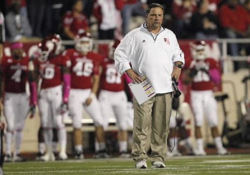 Indiana coach Kevin Wilson waits during a timeout in the second half of an NCAA college football game in Bloomington, Ind., Saturday, Oct. 13, 2012. Ohio State won the game 52-49. (AP Photo/Sam Riche