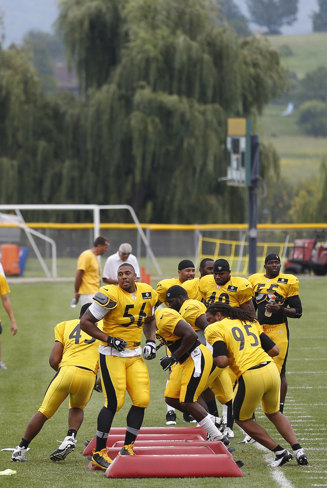 Pittsburgh Steelers outside linebacker LaMarr Woodley (56) performs agility drills with the linebackers at the start of practice during NFL football training camp in Latrobe, Pa. on Wednesday, July 31, 2013. (AP Photo/Keith Srakocic)