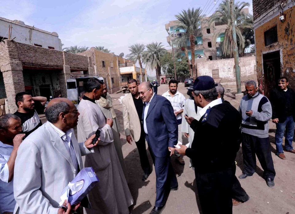 Luxor Governor Ezzat Saad, center, speaks to reporters in al-Dhabaa village, just west of the city of Luxor, 510 kilometers (320 miles) south of Cairo, Egypt, Tuesday, Feb. 26, 2013. A hot air balloon flying over Egypt's ancient city of Luxor caught fire and crashed into a sugar cane field on Tuesday, killing at least 18 foreign tourists, a security official said. The casualties included French, British, Belgian, Hungarian, Japanese nationals and nine tourists from Hong Kong, Luxor Governor, Saad told reporters. (AP Photo/Ibrahim Zayed)