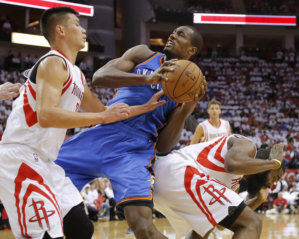 Photo - Oklahoma City's Serge Ibaka (9) grabs the ball between Houston's Jeremy Lin (7) and James Harden (13) during Game 3 in the first round of the NBA playoffs between the Oklahoma City Thunder and the Houston Rockets at the Toyota Center in Houston, Texas, Sat., April 27, 2013. Oklahoma City won 104-101. Photo by Bryan Terry, The Oklahoman