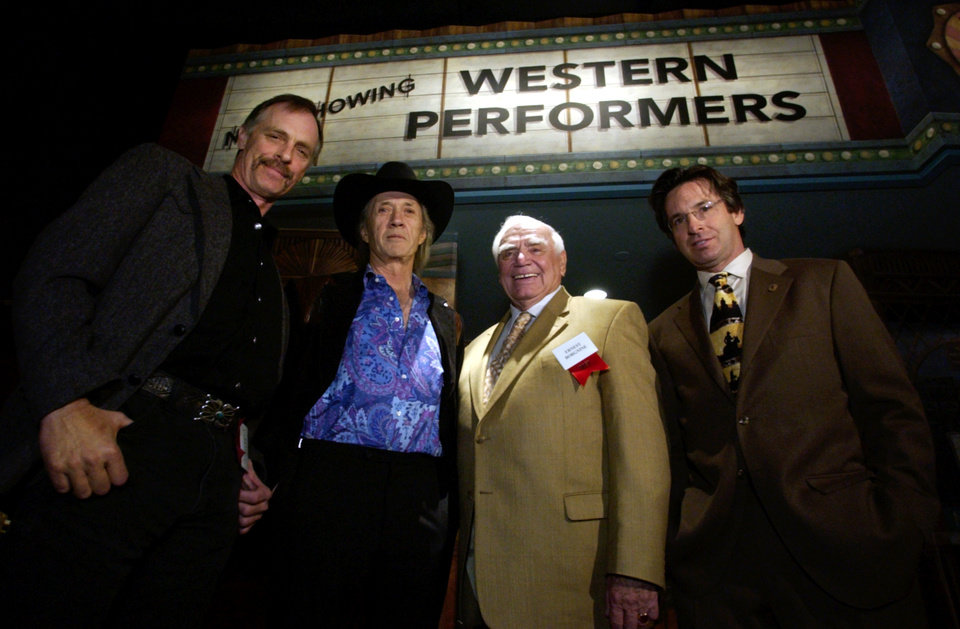 Photo - Oklahoma City: Friday, April 11, 2003:  Keith, David and Robert Carradine stand with Ernest Borgnine in front of a faux-theater inside the National Cowboy & Western Heritage Museum's Western Performers Gallery during the opening Friday night.   Staff Photo by Steve Sisney