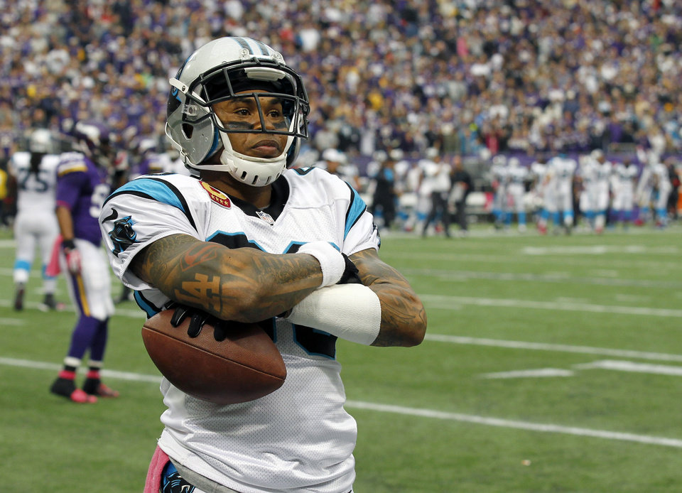 Photo - FILE - In this Oct. 13, 2013 file photo, Carolina Panthers wide receiver Steve Smith crosses his arms after a touchdown catch against the Minnesota Vikings during the first half of an NFL football game in Minneapolis. The agent for  Smith says the five-time Pro Bowl selection has played his final snap for the Panthers. Smith's longtime representative Derrick Fox told The Associated Press on Wednesday, March 12, 2014,  that Smith
