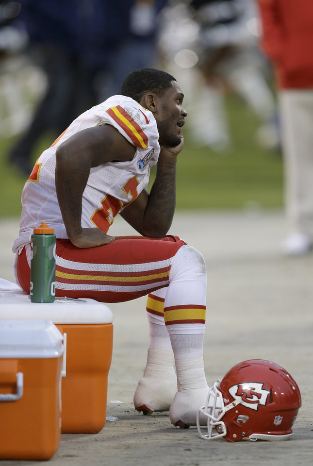 Photo - Kansas City Chiefs wide receiver Dexter McCluster (22) sits on the sideline during the fourth quarter of an NFL football game against the Oakland Raiders in Oakland, Calif., Sunday, Dec. 16, 2012. The Raiders won 15-0. (AP Photo/Ben Margot)