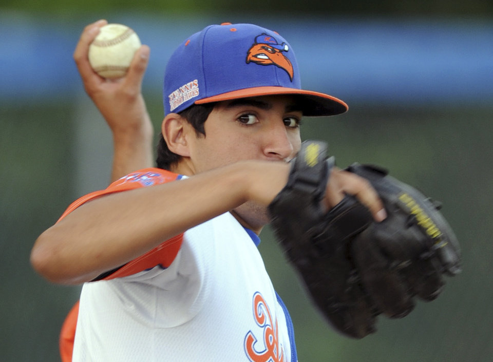 Photo - In this Wednesday, July 30, 2014 photo, Hyannis pitcher Ryan Perez, of Hampshire, Ill., pitches with his left hand during warm-ups before a Cape Cod Baseball League game in Hyannis, Mass. The 20-year-old ambidextrous pitcher from tiny Judson University has blossomed into a potential high-round pick for the 2015 draft with his performances this summer in the prestigious Cape Cod League. (AP Photo/Cape Cod Times, Ron Schloerb) MANDATORY CREDIT: CAPE COD TIMES/RON SCHLOERB