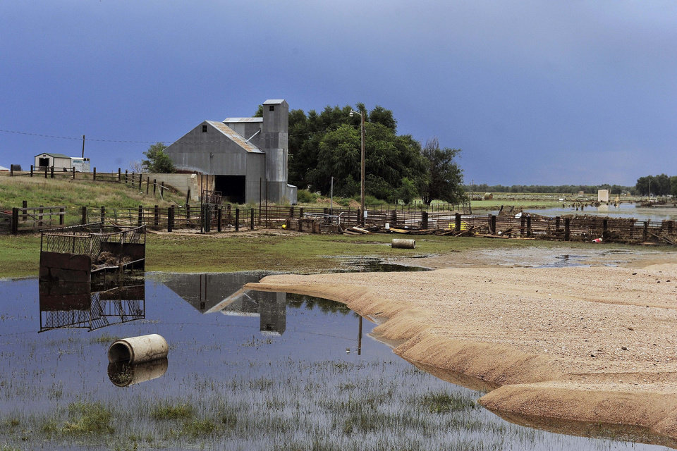 Photo - This photo shows a flooded field near Loveland, Colo., on Wednesday, Sept. 18, 2013. As floodwaters recede, cleanup and damage assessment continues after historic flooding. (AP Photo/Chris Schneider)