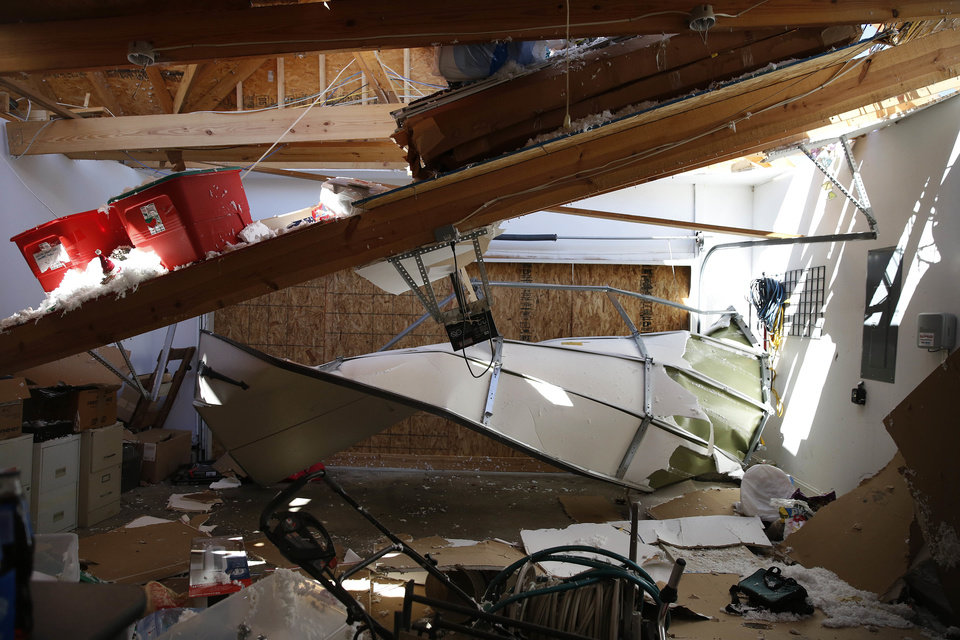 Photo - Emmett Wingfield's attic protrudes into his garage on Wednesday, March 2, 2016, in Bessemer, Ala. after storms struck Tuesday evening.  Forecasters say a tornado that severely damaged homes and trees in the Birmingham suburb has been determined as an EF2, with winds of between 120 and 125 mph.   (AP Photo/Brynn Anderson)