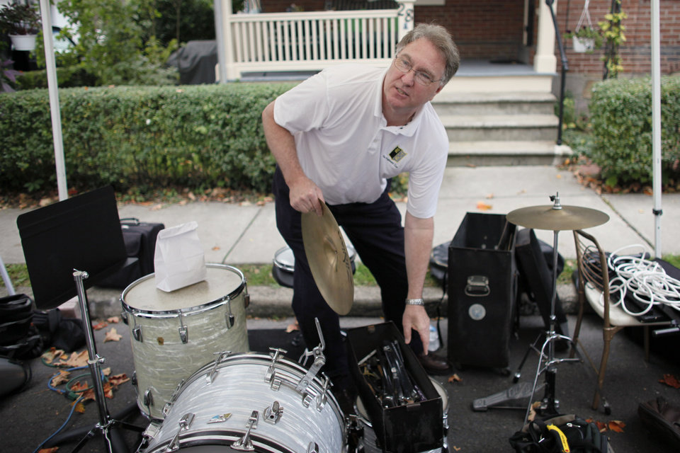 "Rick Renz, who plays drums in a ""Jazz with Friends"" band, packs away his instrument, Saturday Oct. 6, 2012, in Doylestown Pa. Renz, 58, a sales manager, says he has never felt so disheartened about his country. His two older children, ages 33 and 27, both with masters degrees, have had to move back home because they can't find jobs. And he has witnessed friends lose jobs or have their homes foreclosed on. (AP Photo/ Joseph Kaczmarek)"
