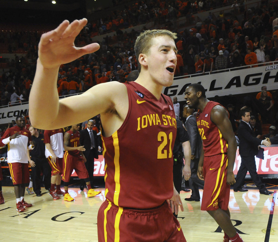 Photo - Iowa State center Matt Thomas celebrates with teammates following a triple overtime win in an NCAA college basketball game in Stillwater, Okla., Monday, Feb. 3, 2014. Thomas scored 6 points in Iowa State's 98-97 win. (AP Photo/Brody Schmidt)