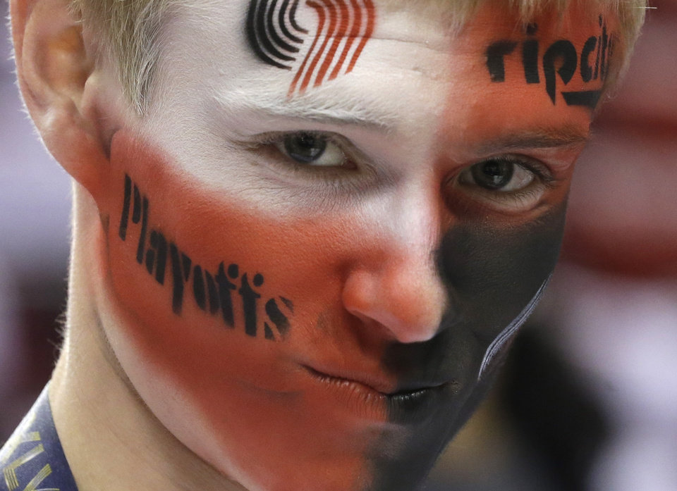 Photo - Portland Trail Blazers fan Jacob Weis watches practice before Game 4 of a Western Conference semifinal NBA basketball playoff series against the San Antonio Spurs Monday, May 12, 2014, in Portland, Ore. (AP Photo/Rick Bowmer)