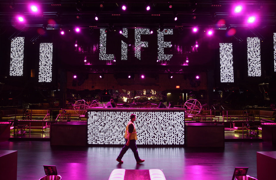 Photo - In this photo taken on Aug. 20, 2014, a man walks through the Life Nightclub in the SLS Las Vegas in Las Vegas. The hotel and casino, formally known as the Sahara, has gone through extensive renovations is scheduled to open this weekend. (AP Photo/John Locher)