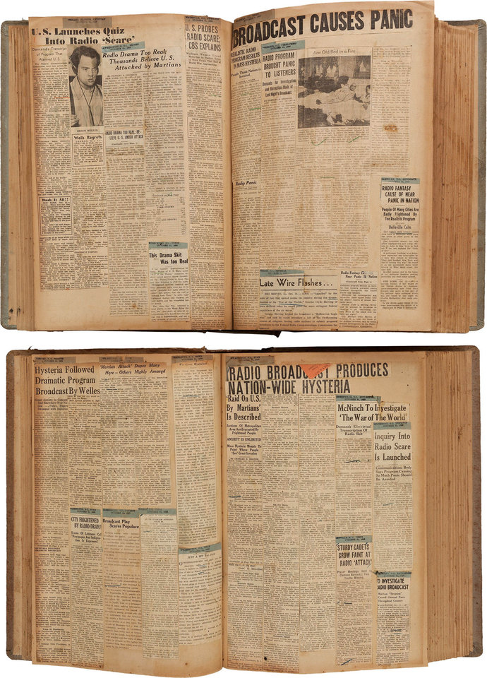 Photo - FILE - This undated file photo provided by Heritage Auctions shows two scrapbooks filled with newspaper clippings about the nationwide panic from Orson Welles' 1938 radio broadcast of