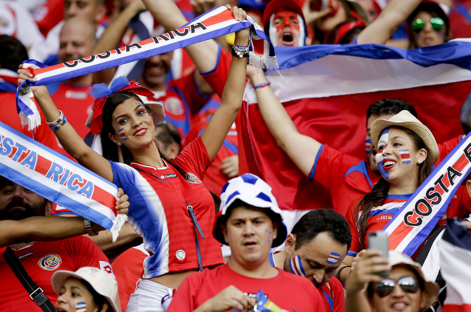 Photo - Costa Rican fans react before the World Cup quarterfinal soccer match between the Netherlands and Costa Rica at the Arena Fonte Nova in Salvador, Brazil, Saturday, July 5, 2014. (AP Photo/Matt Dunham)