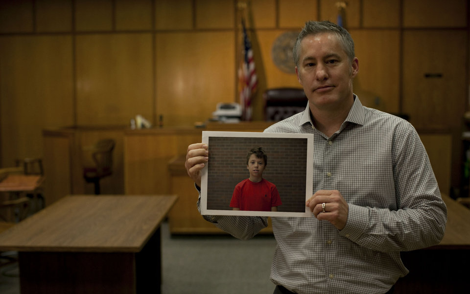 Photo - Advocate volunteer Loren James in the Oklahoma County Juvenile Courtroom.