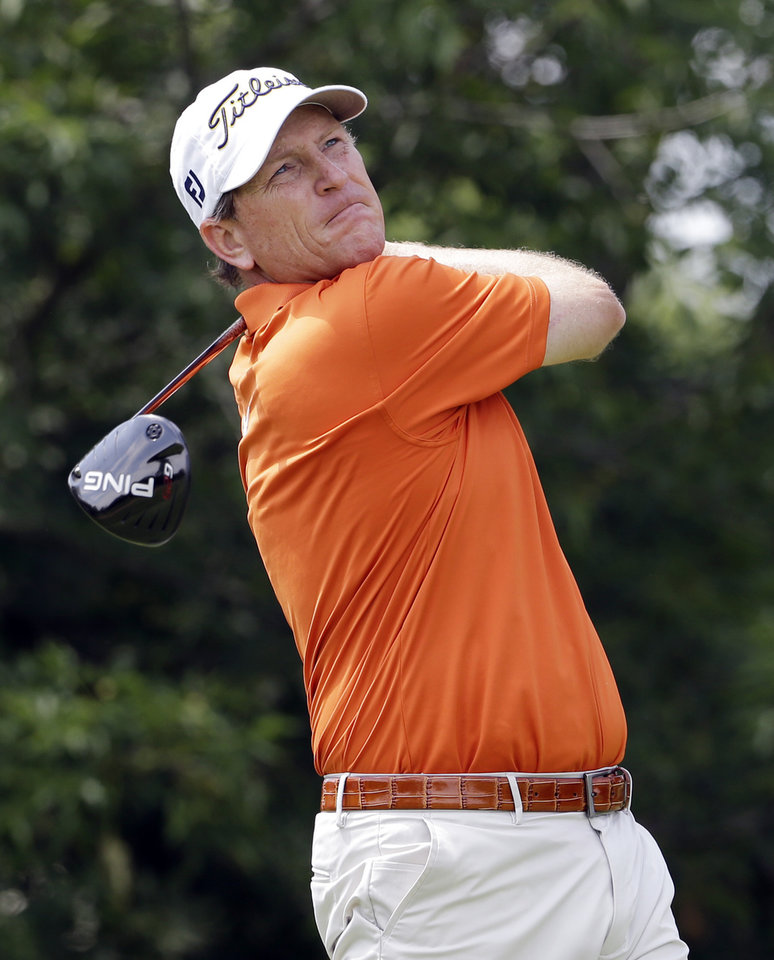 Photo - John Inman watches after hitting a tee shot on the third hole during the second round of the Encompass Championship golf tournament in Glenview, Ill., Saturday, June 21, 2014. (AP Photo/Nam Y. Huh)
