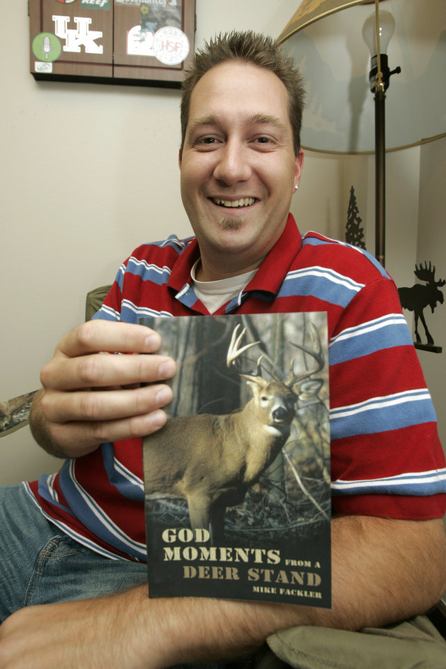 Photo - Mike Fackler holds a copy of his book