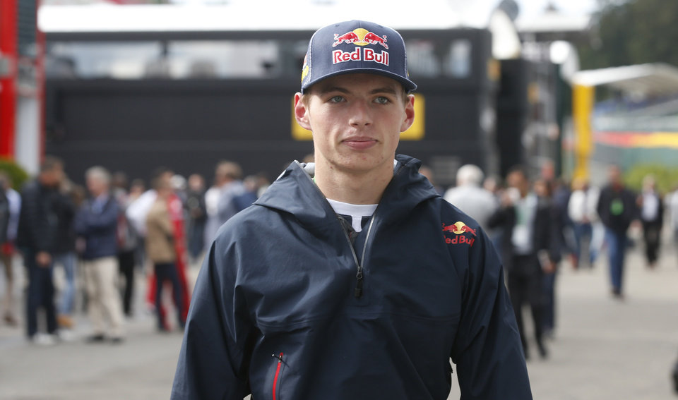 Photo - Dutch driver Max Verstappen arrives to attend a news conference at the Spa-Francorchamps circuit, Belgium, Friday, Aug. 22, 2014. Max Verstappen will become the youngest ever F1 driver when he makes his debut at the age of 17 in next year's championship replacing Scuderia Toro Rosso driver Jean-Eric Vergne of France. The Belgium Formula One Grand Prix will be held on Sunday. (AP Photo/Luca Bruno)