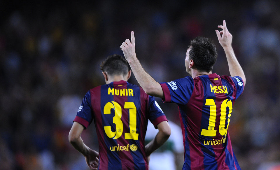 Photo - FC Barcelona's Lionel Messi from Argentina, right, reacts after scoring against Elche during a Spanish La Liga soccer match at the Camp Nou stadium in Barcelona, Spain, Sunday, Aug. 24, 2014. (AP Photo/Manu Fernandez)