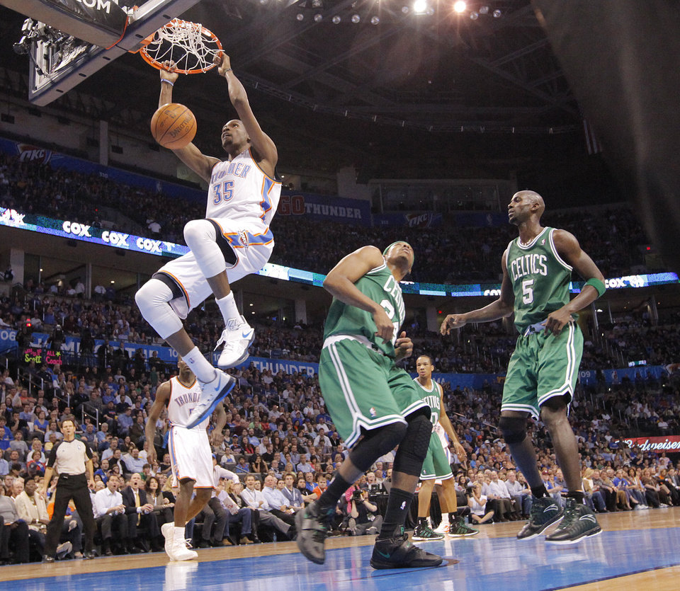 Photo - Oklahoma City Thunder small forward Kevin Durant (35) dunks the ball overBoston Celtics small forward Paul Pierce (34) andBoston Celtics power forward Kevin Garnett (5) during the NBA basketball game between the Oklahoma City Thunder and the Boston Celtics at the Chesapeake Energy Arena on Wednesday, Feb. 22, 2012 in Oklahoma City, Okla.  Photo by Chris Landsberger, The Oklahoman