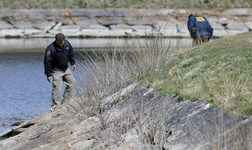 Photo -   Police look along the bank of the Chestnut Hill Reservoir in Boston, where the body Boston College student Franco Garcia was recovered Wednesday, April 11, 2012. Garcia disappeared Feb. 22 after leaving a popular bar near the college. (AP Photo/Michael Dwyer)