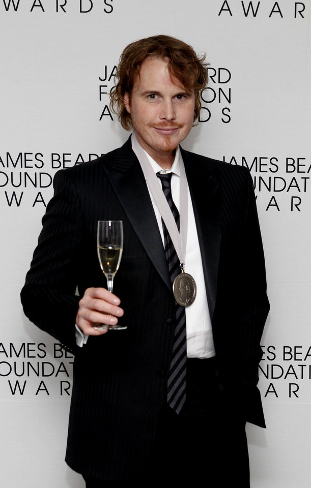 Photo -   Chef Grant Achatz poses after his Who's Who of Food & Beverage in America induction during the James Beard Foundation Awards, Monday, May 7, 2012, in New York. (AP Photo/Jason DeCrow)