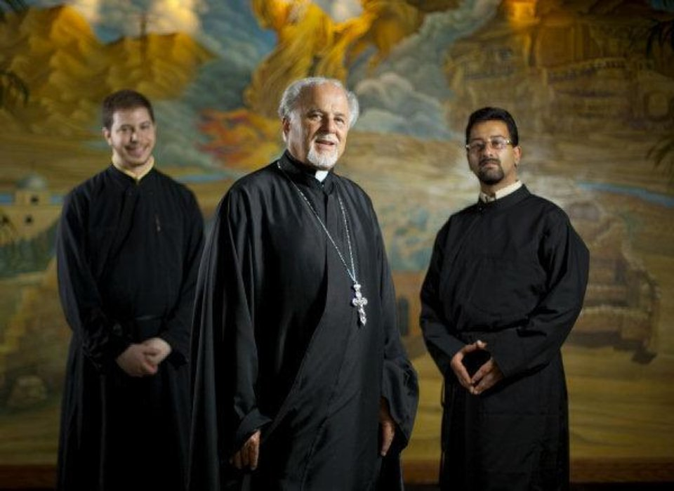 Photo - The Rev. Constantine Nasr poses for a photo with two men he is mentoring, Joseph Hazar, left, and Raja Khoury inside St. Elijah Antiochian Orthodox Christian Church in Oklahoma CIty.  BRYAN TERRY - THE OKLAHOMAN