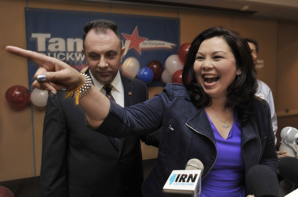 Photo -   Tammy Duckworth, the Democratic nominee for the Illinois' 8th congressional district of the United States House of Representatives celebrates with husband Bryan Bowlsbey after defeating Rep. Joe Walsh in Elk Grove Village, Ill., Tuesday, Nov. 6, 2012. Duckworth, an Iraq War Veteran, served as a U.S. Army helicopter pilot and suffered severe combat wounds, losing both of her legs. (AP Photo/Paul Beaty)