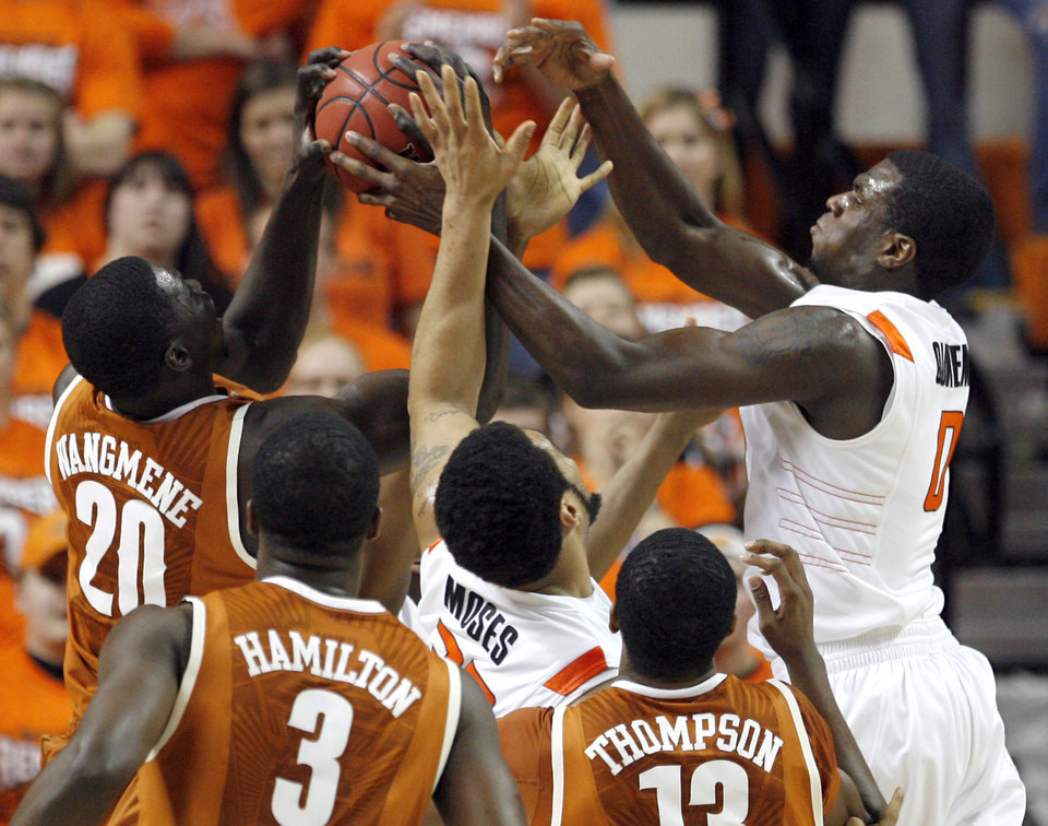 Oklahoma State\'s Marshall Moses (33) and Oklahoma State\'s Jean-Paul Olukemi (0) fight Texas\' Alexis Wangmene (20), Jordan Hamilton (3) and Tristan Thompson (13) for a rebound during the basketball game between Oklahoma State and Texas, Wednesday, Jan. 26, 2011, at Gallagher-Iba Arena in Stillwater, Okla. Photo by Sarah Phipps, The Oklahoman ORG XMIT: KOD
