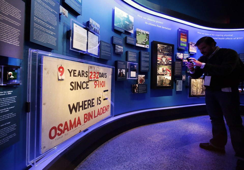 Photo - FILE- In this May 14, 2014 file photo, a sign tracking the time Osama Bin Laden was at large is displayed at the National Sept. 11 Memorial Museum in New York. The museum is the latest in a series of memorials-as-museums that seek to honor the dead while presenting a full, fair history of the event that killed them. And the Sept. 11 museum strives to do that at ground zero while the attacks are still raw memories for many.  (AP Photo)