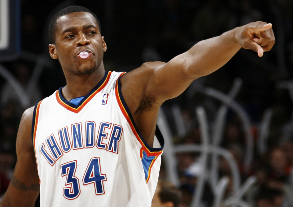 Photo - Oklahoma City's Desmond Mason points after the Thunder forced a turnover in the second half of the NBA basketball game between the Toronto Raptors and the Oklahoma City Thunder at the Ford Center in Oklahoma City, Friday, Dec. 19, 2008. The Thunder won, 91-83. BY NATE BILLINGS, THE OKLAHOMAN