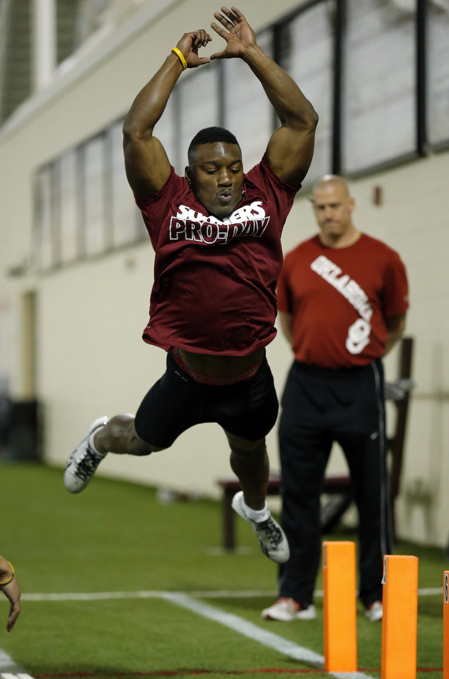 Photo - Sooner running back Roy Finch goes through drills as the University of Oklahoma holds Pro Day at the Everest Training Center in Norman, Okla., on Wednesday, March 12, 2014. Photo by Steve Sisney, The Oklahoman