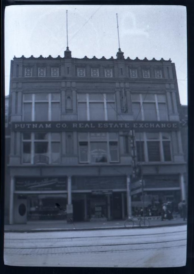 Photo -  The Putnam Co. Real Estate Exchange building was home to Westfall Drugstore, which donated the Vest Kodak Camera and processed negatives of photos taken for inclusion in the First Lutheran Church Century Chest.
