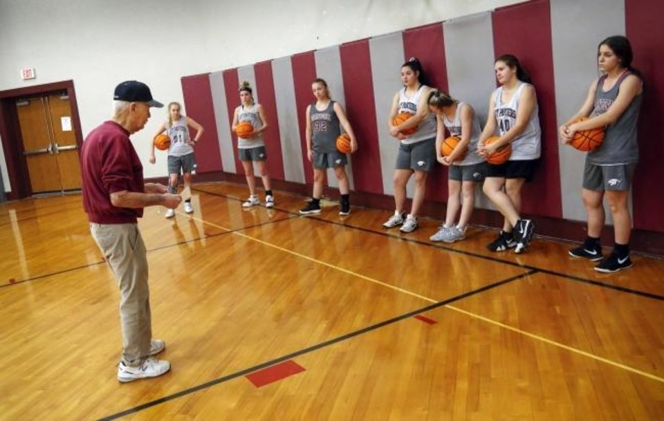 Photo -  Coach Joe Gilbert talks to his girls basketball players at the start of practice in the gym inside Barnsdall High School last week. Gilbert has coached at Barnsdall since 1954. [Nate Billings/The Oklahoman]