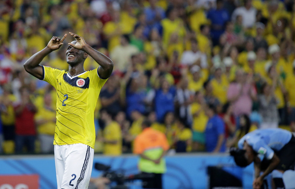 Photo - Colombia's Cristian Zapata celebrates after the World Cup round of 16 soccer match between Colombia and Uruguay at the Maracana Stadium in Rio de Janeiro, Brazil, Saturday, June 28, 2014.  Colombia won the match 2-0. (AP Photo/Sergei Grits)