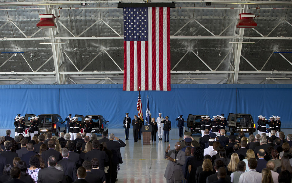 Photo -   President Barack Obama and Secretary of State Hillary Rodham Clinton attend the Transfer of Remains Ceremony, Friday, Sept. 14, 2012, at Andrews Air Force Base, Md., marking the return to the United States of the remains of the four Americans killed this week in Benghazi, Libya. (AP Photo/Carolyn Kaster)